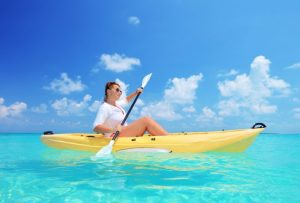 Woman Kayaking on Pretty Ocean