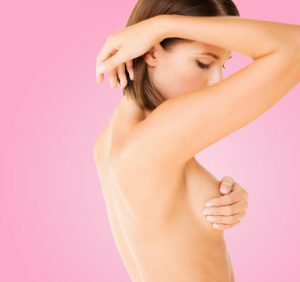 woman checking breast for signs of cancer-img-blog